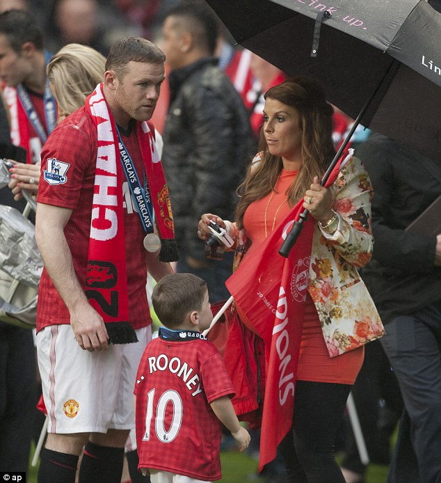 Down in the dumps? Rooney was joined by his wife Coleen (right) and their son on the pitch