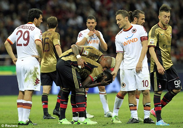 Dismissed: Sulley Muntari was sent off for restraining the referee