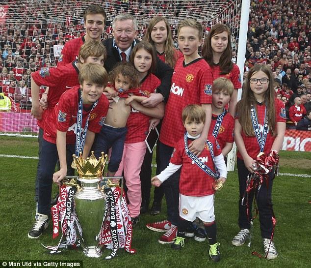 Delight: Sir Alex Ferguson celebrates with his grandchildren and the Premier League Trophy