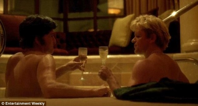 Champagne bath: In this image from the film, Behind The Candelabra, Michael Douglas and Matt Damon's characters clink expensive crystal champagne glasses and gaze into each other's eyes