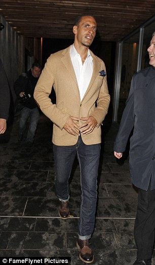 Walk this way: Rio Ferdinand appeared to be by himself and without his wife