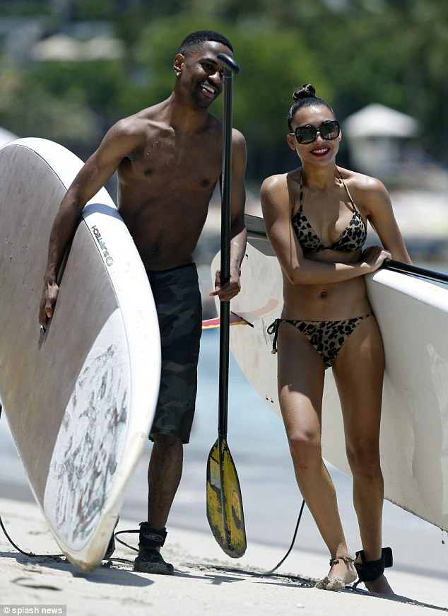 Heating up: Glee actress Naya Rivera and new boyfriend Big Sean proved that they're still going strong as they holidayed together in Hawaii on Sunday