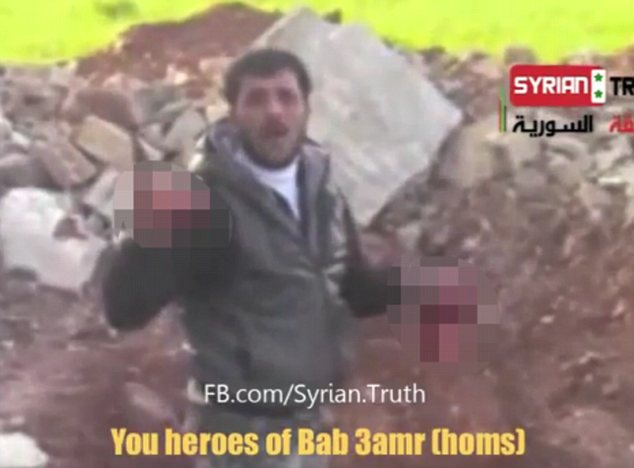 Gory: Brandishing the organs for the camera to see, Sakkar continues his rant against Assad's government