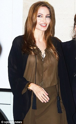 Brave choice: Angelina looked in good spirits as she attended the Women in the World event following the initial stage of the procedures