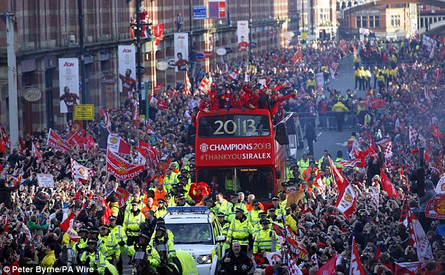 Meanwhile: United were enjoying an open-top bus title parade in Manchester on Monday