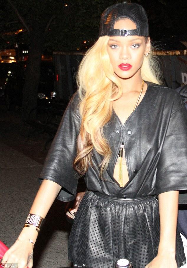 Rihanna Swaps Short Platinum Fringed Wig For Luscious
