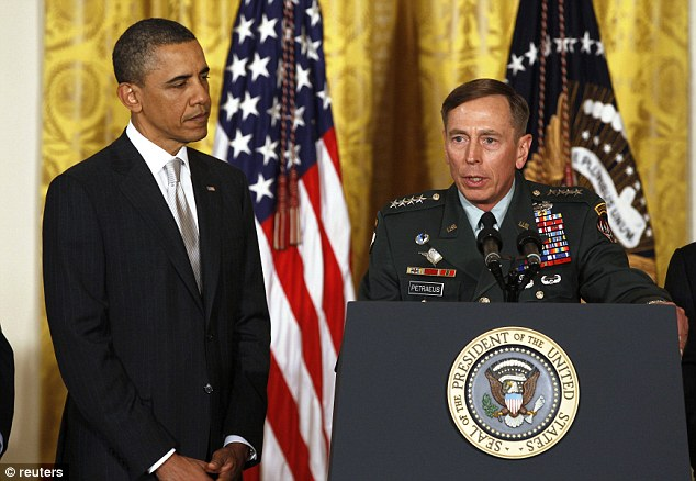 Disagreement: U.S. Army Gen. David Petraeus talks next to U.S. President Barack Obama at an event in the East Room of the White House in this April 28, 2011 file photo