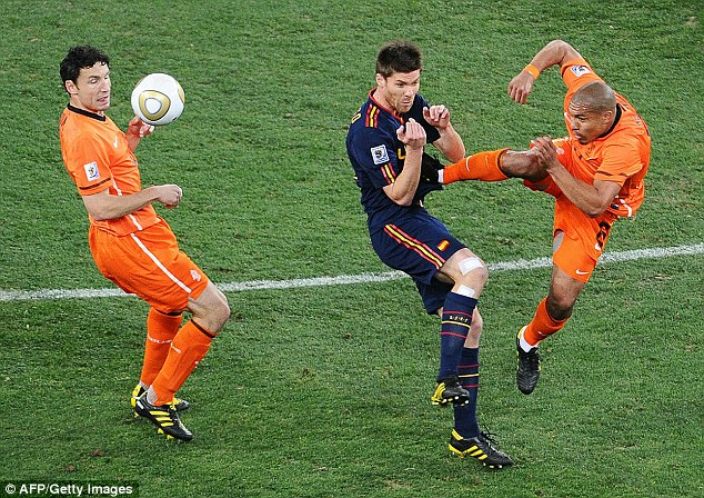 Ouch: Nigel de Jong escaped a red card for this lunge on Xabi Alonso in the World Cup final