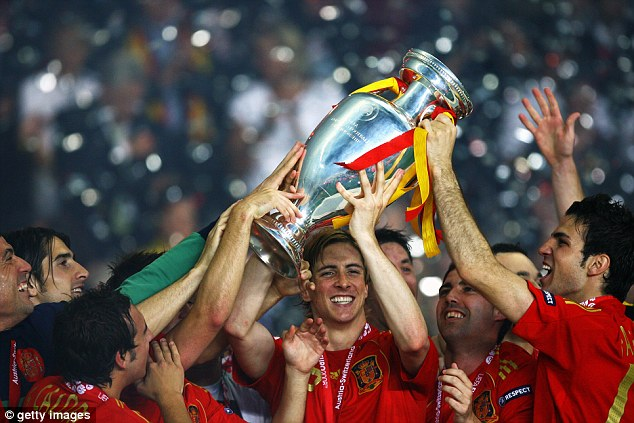 Country boy! Torres lifted the European Championship trophy with Spain after netting the winner in 2008