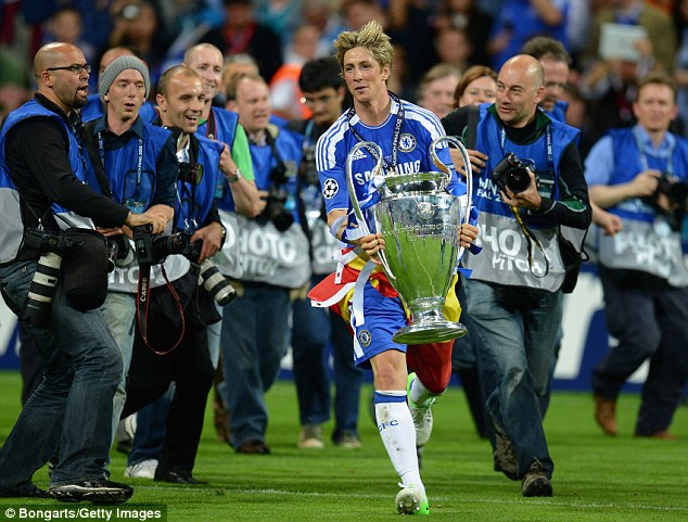 And another one: Torres parades the Champions League trophy on the pitch at the Allianz Arena last season