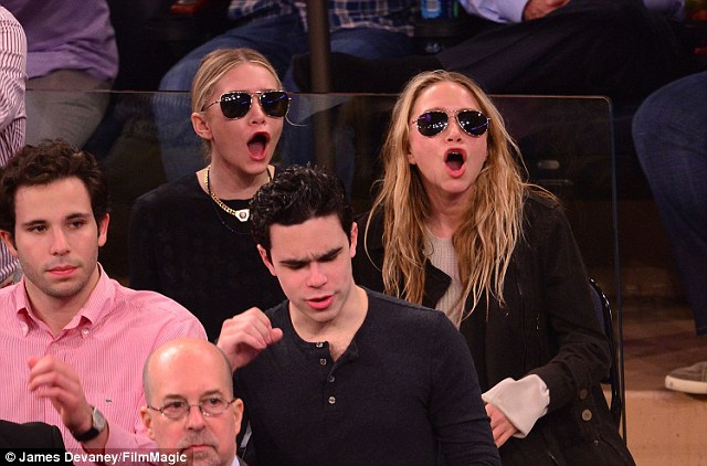 Sister, sister: Ashley (L) and Mary Kate (R) Olsen were comically in sync as they cheered on the Indiana Pacers versus New York Knicks basketball game in New York on Thursday night