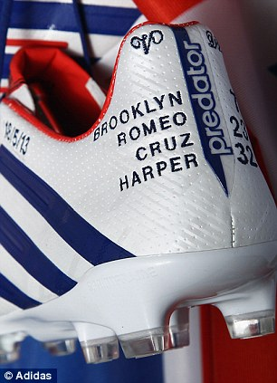 The boots feature his kids' names