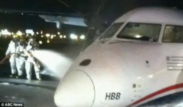 Belly landing: The plane was doused in foam as it landed at Newark