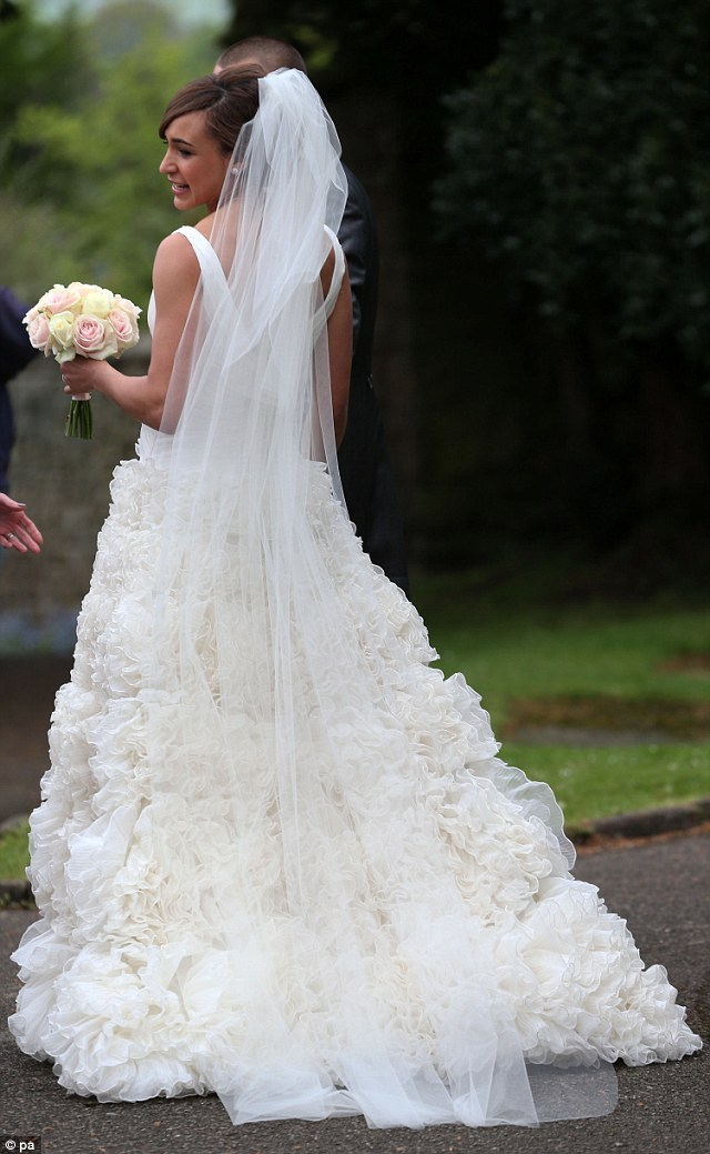 Blushing bride: Jessica has so far remained tight-lipped about who designed her dress