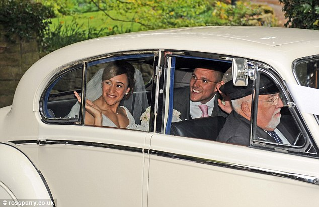 True romance: The couple looked the picture of happiness as they emerged from the service in a vintage car