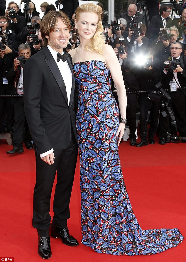 Loved up as ever: Nicole Kidman and Keith Urban pose together on the red carpet of the screening of Inside Llewyn Davis at the Cannes Film Festival