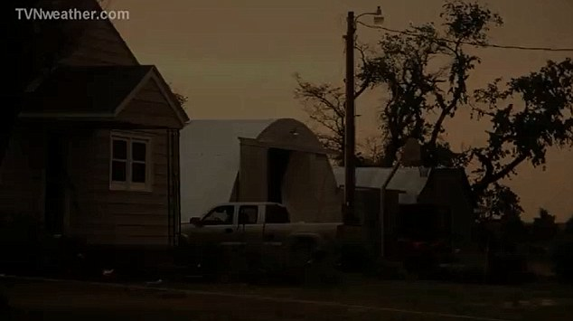 Ominous: The sky darkened as the tornadoes ripped across the open plains along with ping-pong ball sized hail