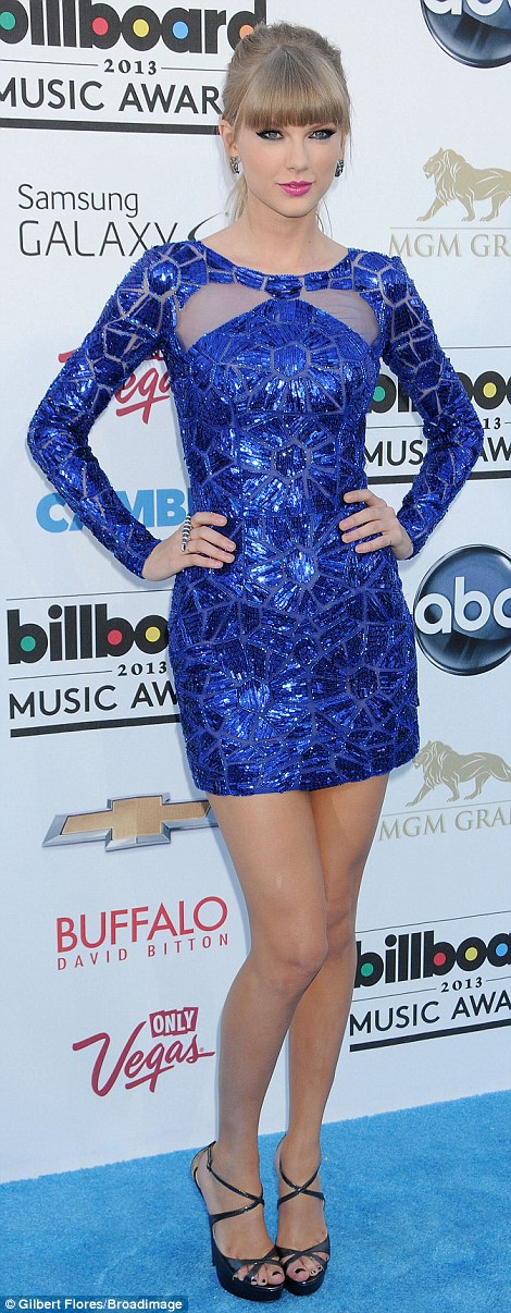 True blue: Also in Zuhair Murad was country-turned-pop crooner Taylor Swift in a shimmering blue mini dress with perfectly placed sheer cut outs