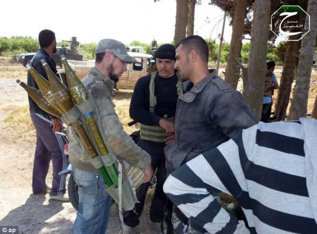 Retaliate: Syrian rebels preparing to repel a coordinated attack by government forces, in Qusair, Homs yesterday