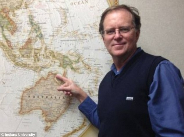 Australian scientist and professor at Indiana University, Ian McIntosh points to the location where the copper coins were found.