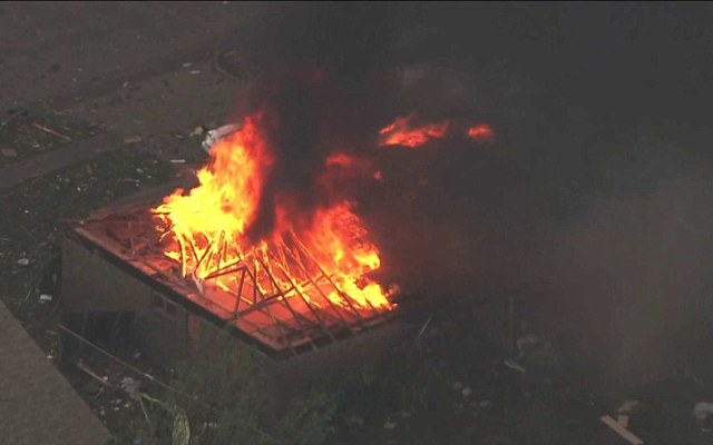 Aftermath: Fires have also broken out at buildings after the monster storm thanks to exposed power lines, CNN reported