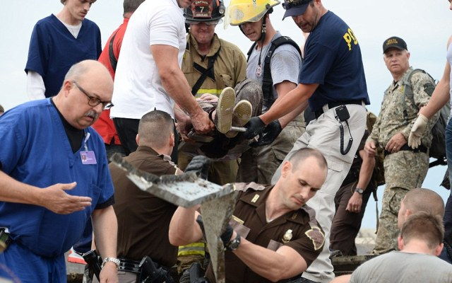Rescue workers help free one of the 15 people that were trap at a medical building at the Moore hospital complex