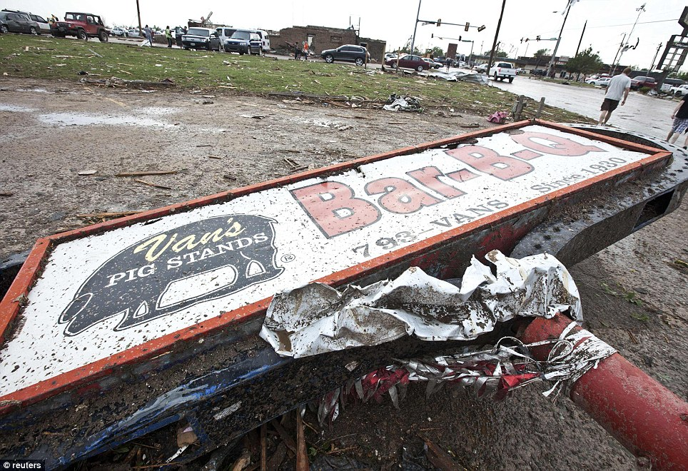 A sign for a local restaurant lies on the ground after a huge tornado struck Moore, Oklahoma, near Oklahoma City