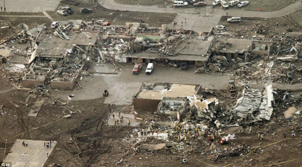 Flattened: This aerial photo shows damage to the Plaza Towers Elementary School after massive tornado hit Moore, south of the city