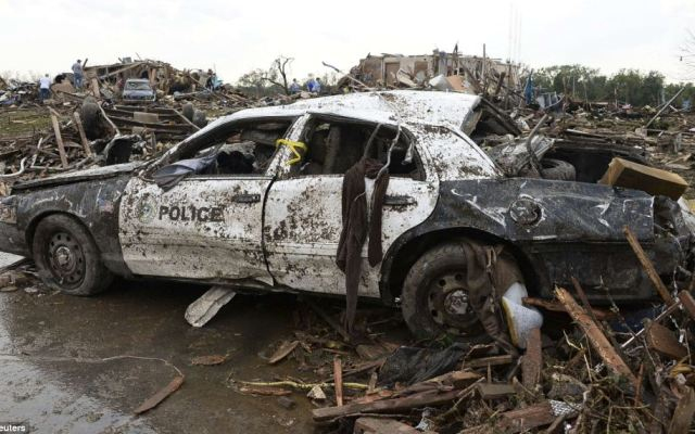 A damaged police car in the midst of debris from the violent storm that lasted 45 minutes
