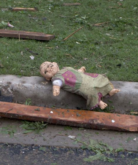 A child's doll on the curb