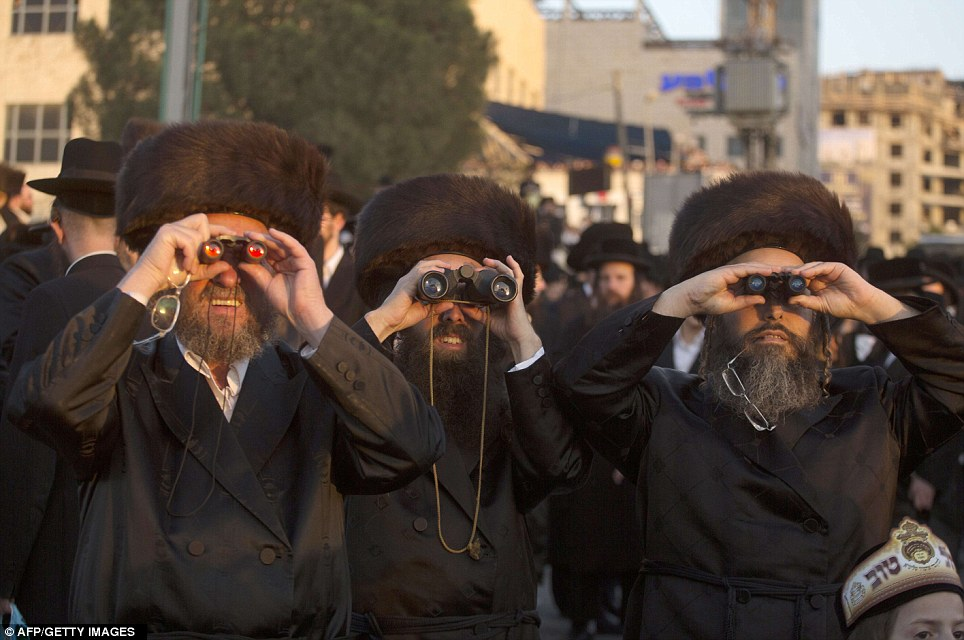 Spectators: Ultra-Orthodox Jews of the Belz Hasidic Dynasty use binoculars to watch the wedding ceremony