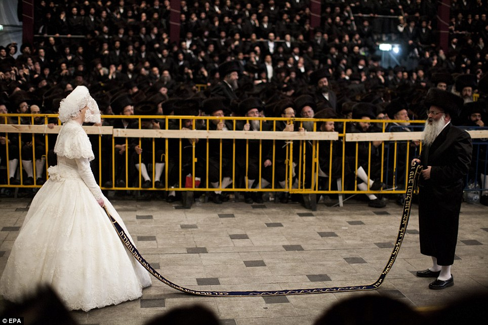 Big event: The wedding - which saw up to 30,000 guests attend - is one of the largest Orthodox Jewish ceremonies in recent years