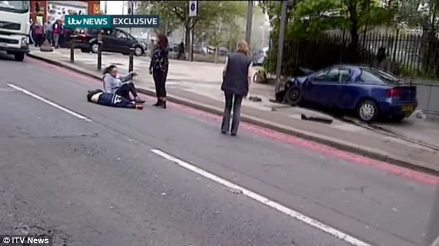 Heroic: Brave women attempt to help and comfort the victim close to the car that apparently struck him