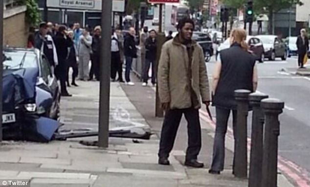 The woman appears to be remonstrating with a man who seems to be carrying a knife at the scene of the incident