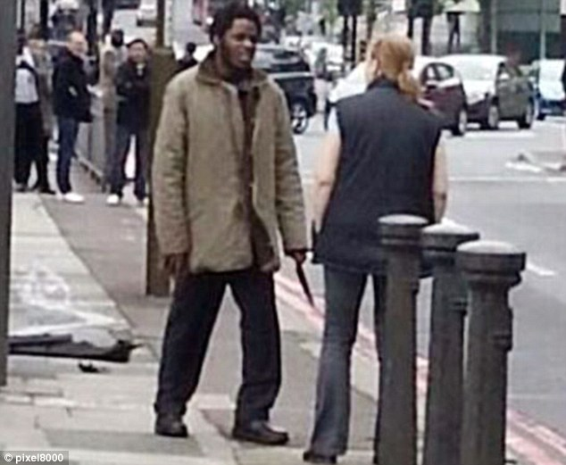 Adebolajo's accomplice was seen talking to 48-year-old Ingrid Loyau-Kennett as she calmed the men down to keep the peace
