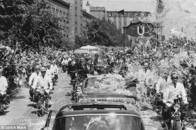 Fans: Thousands of citizens lined the main street in West Berlin as the president arrived flanked by police and bodyguards