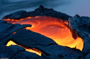 Daredevil photographer gets so close to Hawaiian lava flow