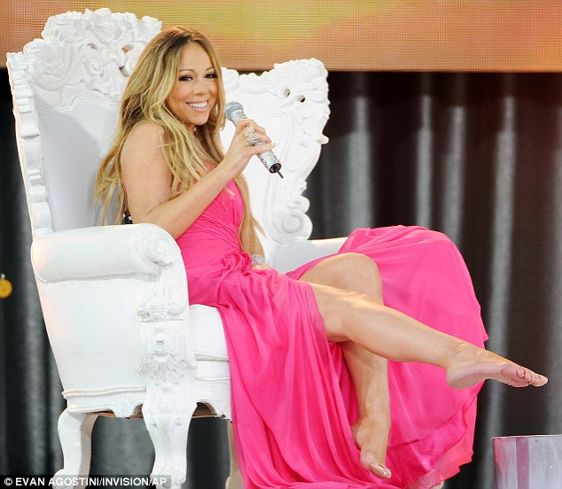 Mariah Carey curses and almost exposes her chest as her