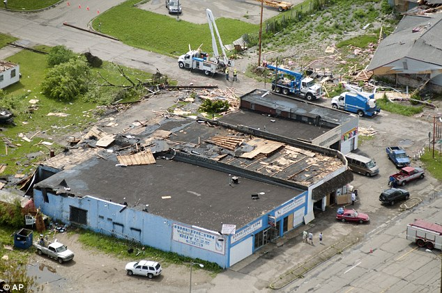 Crews worked to clean up the day after the tornadoes. Seen here, is a business in Mt Morris Township, Michigan