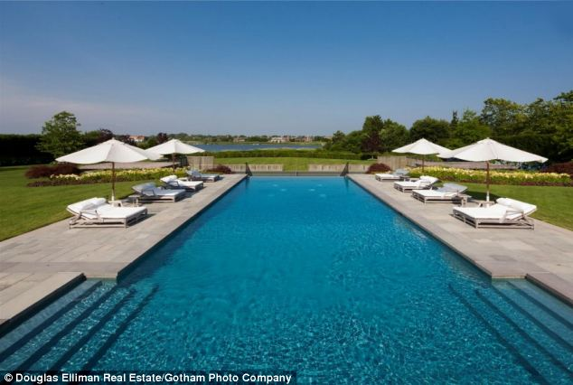 Stunning: The four-acre estate includes an Infinity-edge pool, Jacuzzi and a Koi pond
