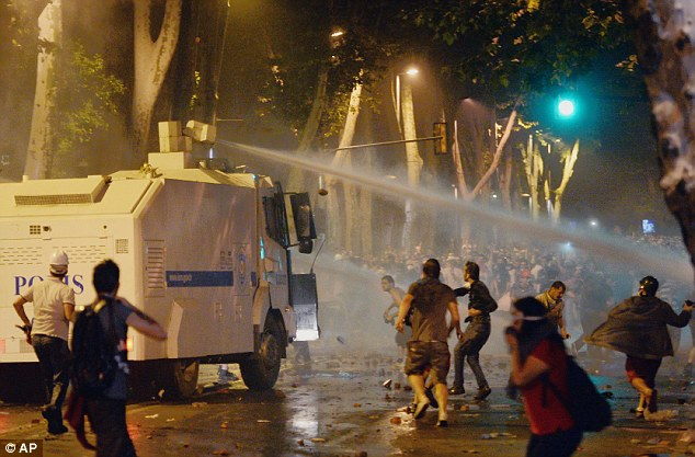 Turkish protesters hurl rocks at riot police near the former Ottoman palace, Dolmabahce, following a police crackdown on a peaceful demonstrations against Prime Minister Recep Tayyip Erdogan's increasingly authoritarian style