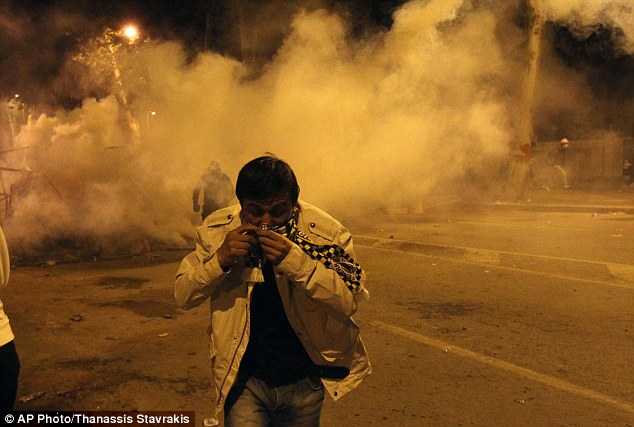 Choke: Turkey's prime minister Recep Tayyip Erdogan rejected claims that he is a 'dictator,' dismissing protesters as an extremist fringe