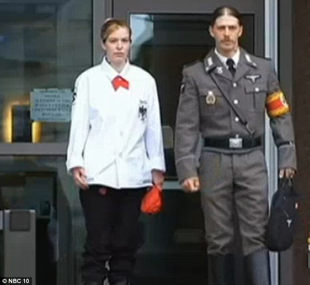 Fascist statement: Heath Campbell, 40, appeared at a New Jersey court today to try to reclaim custody of his children, wearing full Nazi regalia and accompanied by fellow Nazi Bethanie White
