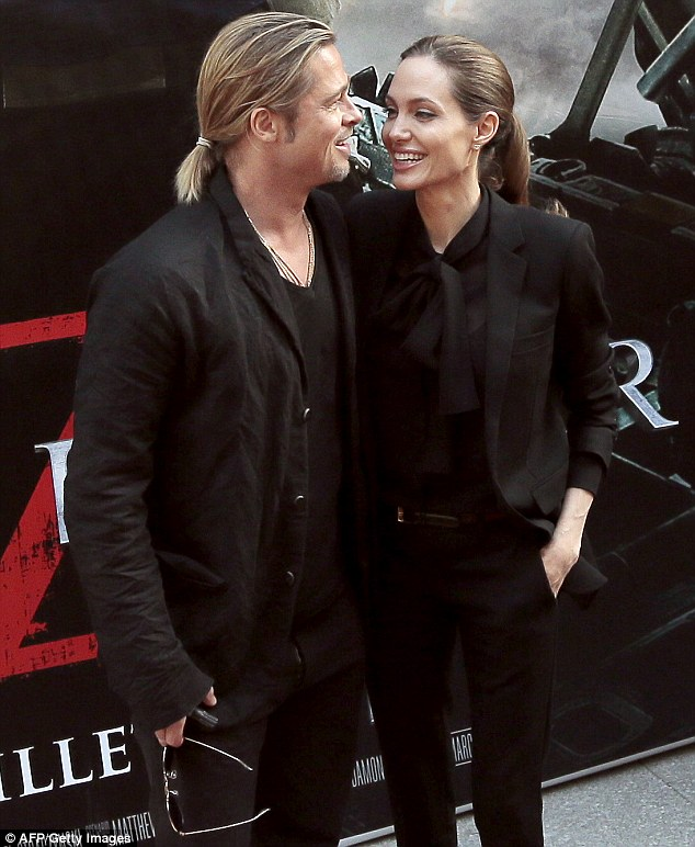 That's my man: Angelina gazes at her future husband as they arrive on the red carpet
