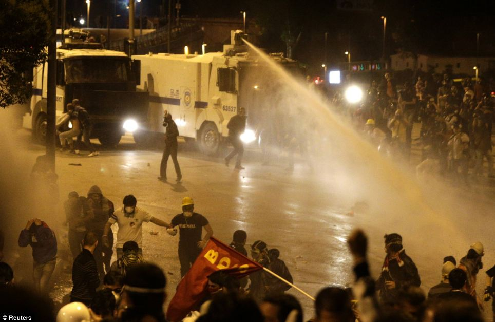 Coming to a street near you soon: Riot police use water cannons to disperse anti-government protesters in Istanbul. UK police have procured several such weapons to deal with expected protests in London