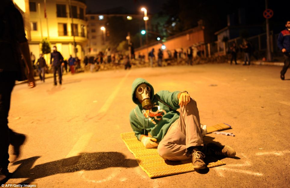 Unafraid: A protestor takes a rest during ongoing demonstrations