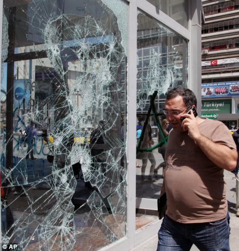 Damage: Windows were smashed during the violent clashes between police and anti-government protestors