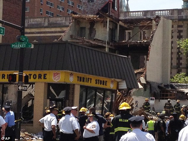 Emergency personnel respond to a building collapse in downtown Philadelphia, where the city fire commissioner says 13 people were pulled from the rubble