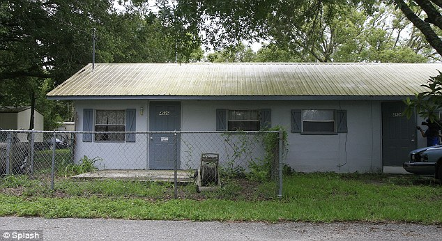 The door on the left is Mrs Mackenzie's home. Before her lottery win, she lived in this squat, modest duplex in Zephyhills, florida