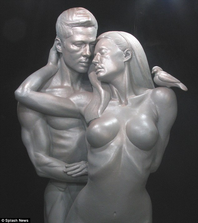 Heated embrace: Edwards made a statue of Brad Pitt and Angelina Jolie in a lovers' embrace titled simply Brangelina, in 2009